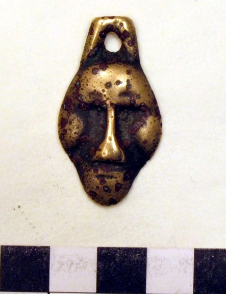 Ancient amulet in the form of a human face, reportedly discovered in Upper Tibet