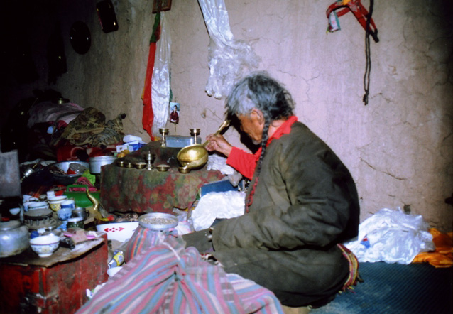 Phowo Sridgyal preparing the altar for a trance ceremony